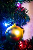 Christmas tree with golden bauble Stock Photography