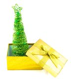 Christmas tree in golden box Royalty Free Stock Photo