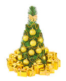 Christmas tree and golden holiday gifts isolated on white backgr Stock Image