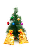 Christmas tree and golden sacks Stock Photography