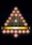 Christmas tree from golden snowflakes with ribbon. Black background with Christmas tree of luminous golden snowflakes and gold ribbon Royalty Free Stock Photo