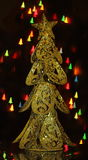 Christmas tree. Golden toy Christmas tree on starry background Stock Photos