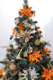 Christmas tree. Golden toys. Christmas tree near a fireplace with firewood Stock Photography