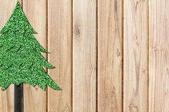 Christmas tree from grass texture on plank wooden Stock Images