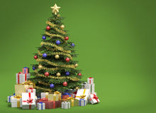 Christmas tree on green background. Fully decorated christmas tree with many presents isolated on green background with copy space on the right Stock Image