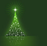 Christmas tree  on green background. Royalty Free Stock Image