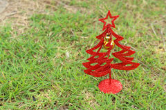 Christmas tree on a green background at the park Stock Photography