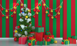 Christmas tree on green and red wall background. Stock Photo
