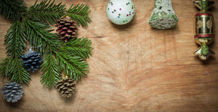 Christmas tree a Green twig and a bell ball on wooden old rustic Royalty Free Stock Photography