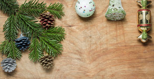 Christmas tree a Green twig and a bell ball on wooden old rustic Stock Photo