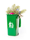 Christmas tree in the green wheelie bin Stock Photos