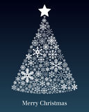 Christmas Tree Greeting Card. A Christmas tree made up of different snowflakes on blue background. Useful also as greeting card. Eps file available Stock Photography