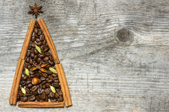 Christmas tree greeting card made of cinnamon and coffee Stock Images