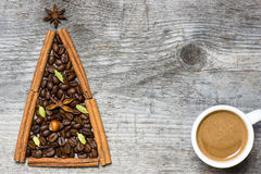 Christmas tree greeting card made of cinnamon and coffee Stock Image
