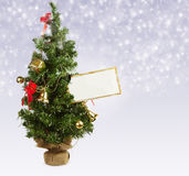 Christmas tree with greeting postcard Royalty Free Stock Images