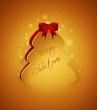 Christmas tree with greetings over golden  background Royalty Free Stock Image