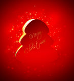 Christmas tree with greetings over red background. Christmas tree with greetings over dark red background Royalty Free Stock Photo