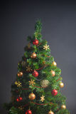 Christmas tree on grey background Royalty Free Stock Photo