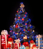 Christmas tree and group gift box. Stock Photo