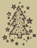 Christmas tree grunge. Christmas tree in brown on a tan background with fragmented stars Stock Photography