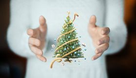 Christmas tree on hand, decorations, gift card Stock Images