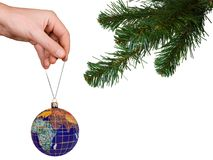 Christmas tree, hand and earth Royalty Free Stock Photography