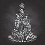 Christmas tree hand-lettering with chalk. Vintage hand-lettering Christmas tree greeting card with chalk on blackboard background Stock Photography