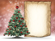 Christmas tree and handmade paper sheet Stock Image