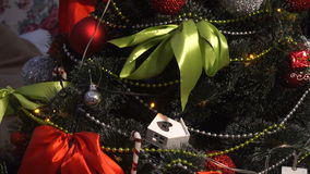 Christmas tree with handmade toys. And red ribbons stock video