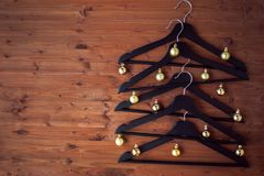 Christmas tree from hangers. Decorated with a gold balls. A concert of Christmas sales. Royalty Free Stock Photo