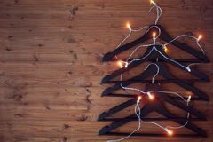 Christmas tree from hangers. Decorated with a luminous garland. A concert of Christmas sales. Royalty Free Stock Image