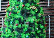 Christmas tree with hanging decorations Stock Image