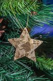 Christmas tree hanging ornament, gold star, close up royalty free stock photos