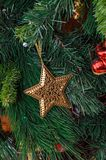 Christmas tree hanging ornament, golden star, close up stock image