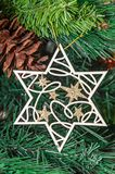 Christmas tree hanging ornament, silver star, close up royalty free stock images