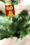 Christmas tree with hanging wooden owl. Christmas tree with bright ornaments and toys. Wisdom symbol. Festive new year decoration. Christmas tree with hanging royalty free stock photos