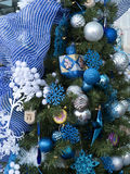 Christmas tree with Hanukkah decorations. Some people with best intention trying to merge the Christian and Jewish holidays, to bridge the chasm and bring Royalty Free Stock Image