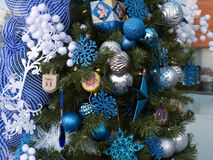 Christmas tree with Hanukkah decorations. Some people with best intention trying to merge the Christian and Jewish holidays, to bridge the chasm and bring royalty free stock photo