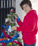 Christmas tree and happy boy portrait Royalty Free Stock Image
