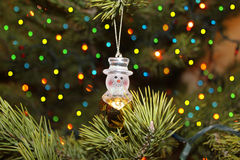 Christmas tree with happy snowman Royalty Free Stock Photo