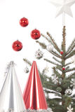 Christmas tree and hats Stock Photography