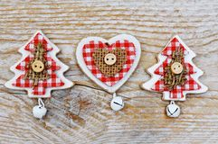Christmas tree and heart decoration on wooden background Stock Images