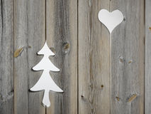 Christmas tree and heart motifs in wooden shutter boards Royalty Free Stock Photos