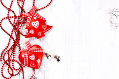 Christmas tree and heart shaped decoration on wooden background Royalty Free Stock Image