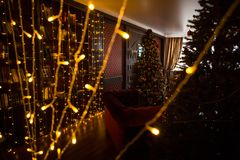 Christmas tree holiday home interior lights garlands, and home decorations. royalty free stock photography