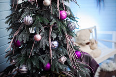 Christmas tree with holiday ornaments and copy space at right. Stock Photo