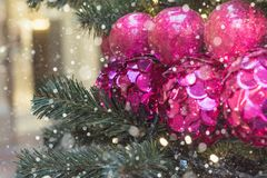 Christmas tree with holiday pink disco balls and lights with copy space on blurred bokeh background in mall. Close up. Copy space Stock Images
