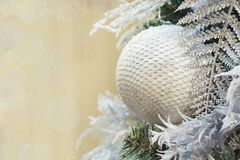 Christmas tree with holiday silver ball and lights with copy space on blurred bokeh background in interiors. Close up. stock photo