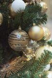 Christmas tree with holiday silver balls and lights with copy space on blurred bokeh in interiors. Close up. Christmas tree with holiday silver balls and lights stock photos