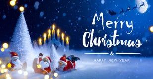 Christmas tree and holidays Santa decoration ornaments;=. Christmas tree and holidays Santa decoration ornaments; Santa Claus flying in his sleigh against moon Stock Photos